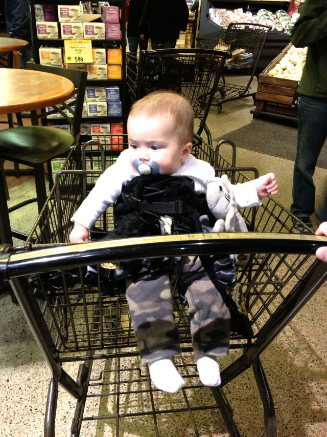 "I was a good sport though. Daddy wrapped my blanket around me a million times so I would be more ""comfortable"" and then strapped me onto the grocery cart. Mom says this is what happens when a man resolves a baby problem. She says he would've used zip ties if he had some on him."