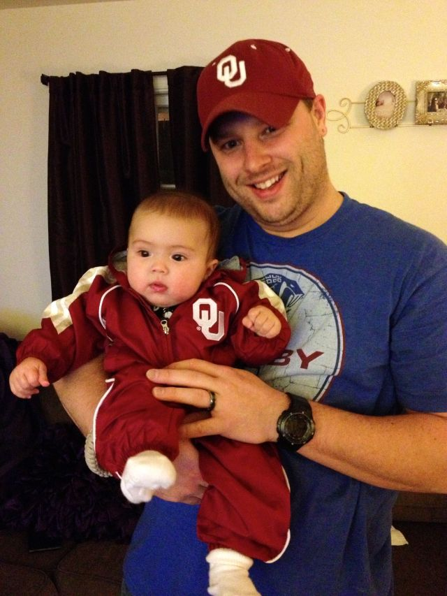 Daddy and I matched! I was a little busy watching the game when Mom took this pic.