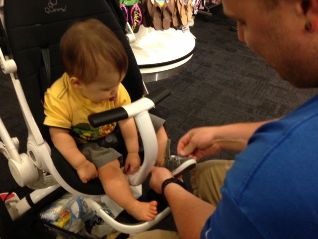 Here they are! Daddy is putting my first pair of walking shoes on.