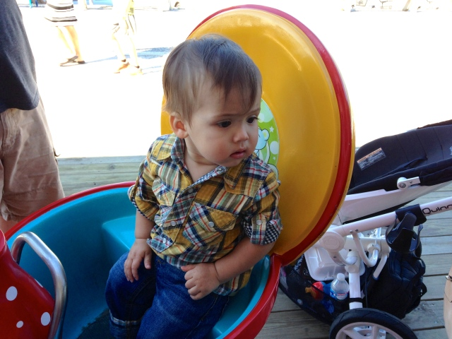 Mama and Daddy took me to the arcade next to the beach and I spun around and around in this little teacup!